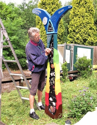 Pat Wilson working on the Mickleover Station milepost – courtesy of Les Sims